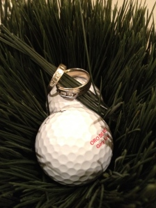 Golf is the favourite sport of Gary King of Oro de Rey. Platinum and diamond engagement and wedding bands sit on the golf balls